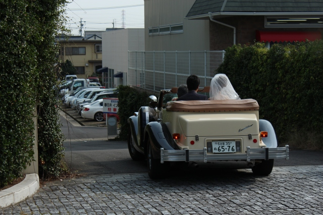 A happy beginning for newlyweds on the way into Nagoya. I couldn't get a picture of the front fast enough.