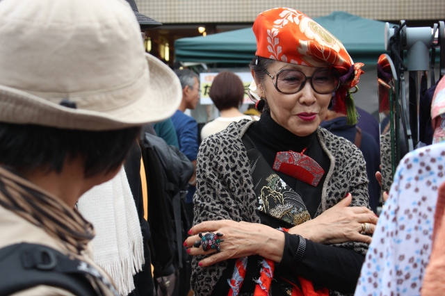 A bold fashionista harkening yoko to the nagoya fall festival.