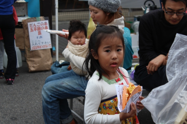 Local oms and noms and a creepy tourist taking photos for this young girl's festival.